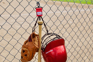 Red Dugout Gear Hanger With Hanging Equipment