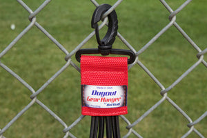Red Dugout Organizer On Chain Link Fence Up Close
