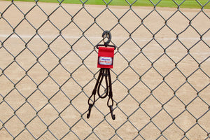 Red Dugout Organizer On Chain Link Fence