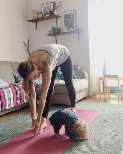 Maggie does yoga with her little one