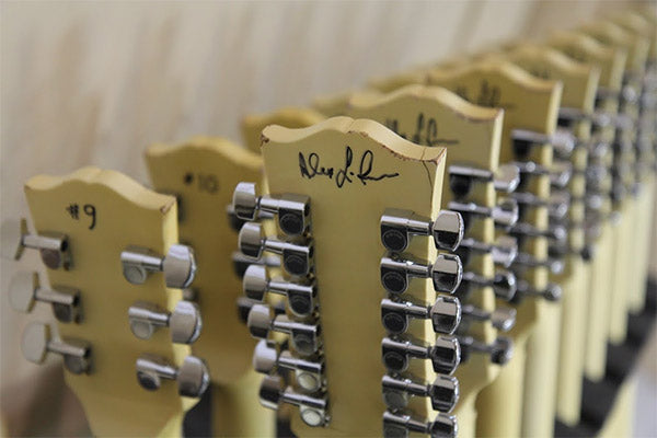 Alex-Lifeson_rack-of-guitars_03_600