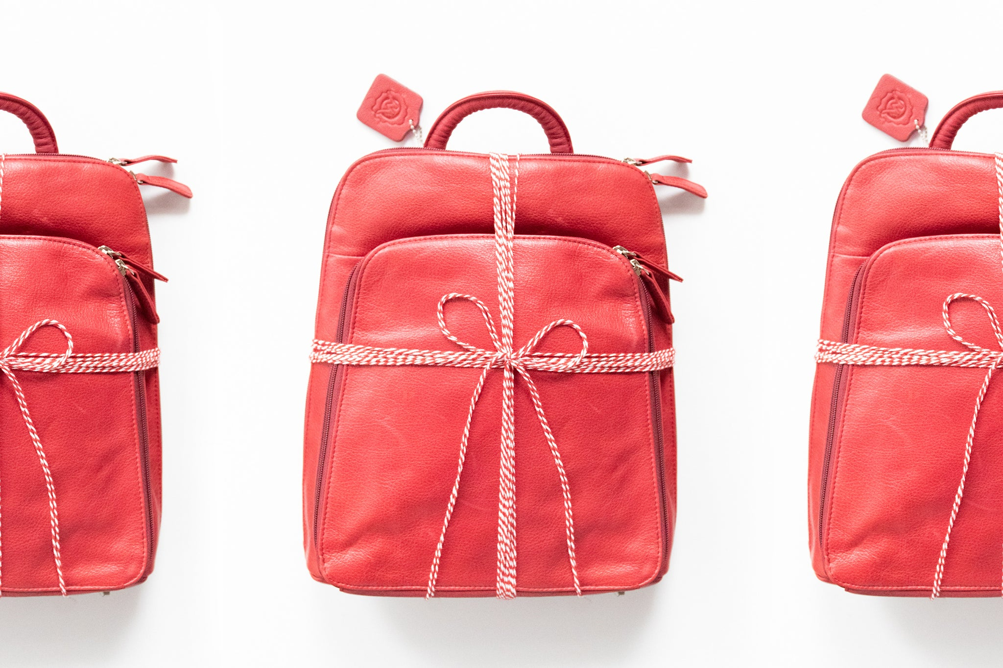 red backpack wrapped in bow