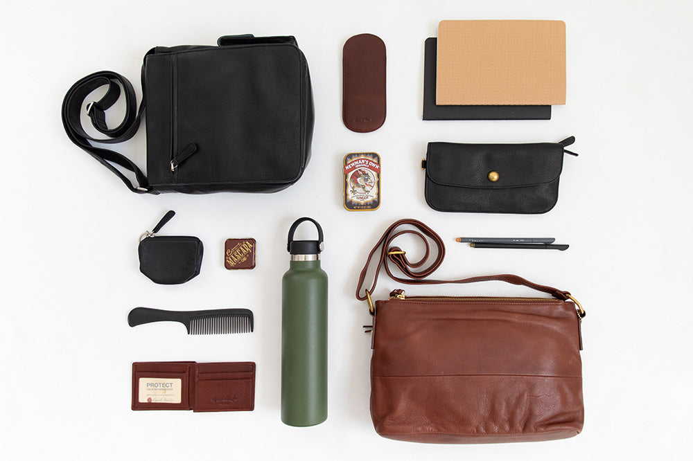 flat lay of messenger bag and it's contents