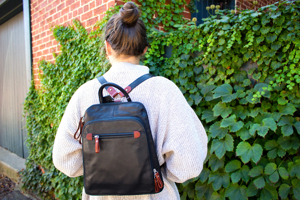 RFID backpack with sweater and ivy brick wall
