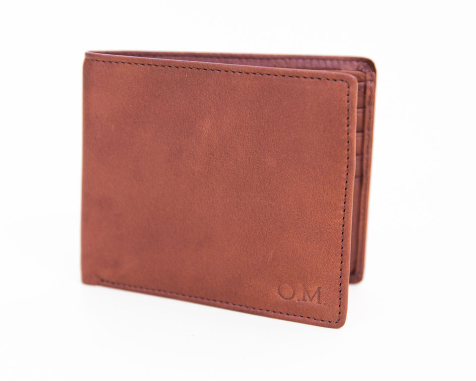 Wallet with imprinted monogram in lower right corner