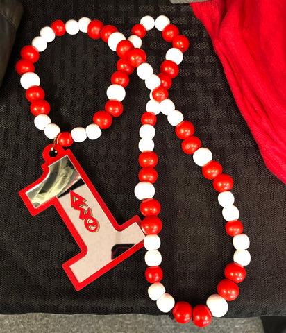 DELTA ACRYLIC LINE NUMBER RED AND WHITE TIKI BEADED NECKLACE, DELTA NECKLACE