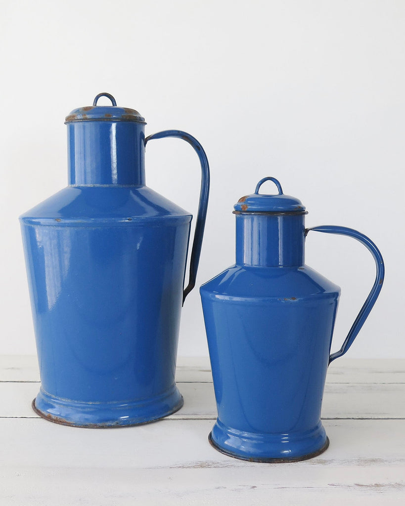Blue enamelware pitchers