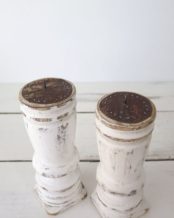 Distressed White Painted Candle Holders top
