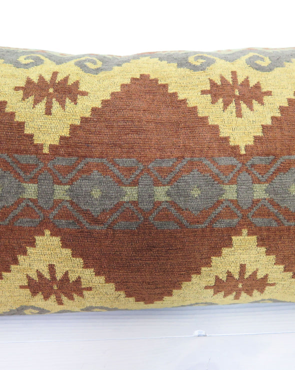 Brown and Gold Geometric Lumbar Pillow  close up