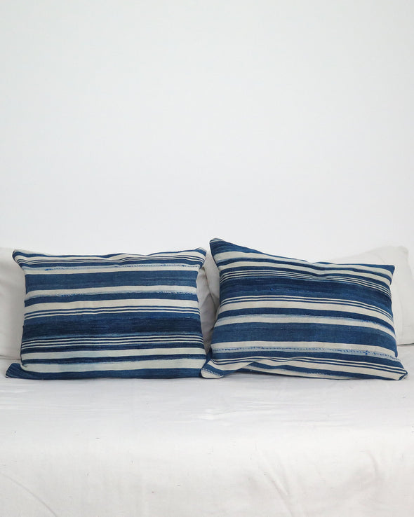 Vintage Burkina Faso Striped Pillows on bed
