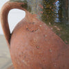 Imported Turkish terracotta olive jar close up