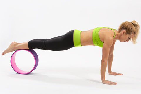 5 Yoga Wheel Exercises to Build Strength
