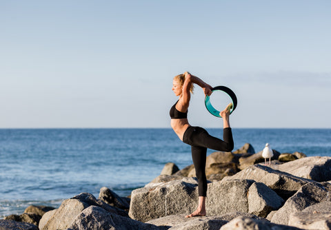 4 Ways to Use a Yoga Wheel in Your Flow (That Aren't Backbends)