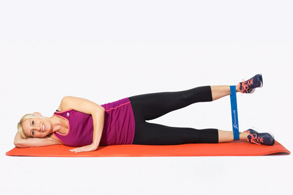 woman using prosourcefit loop resistance band for side lying leg lifts