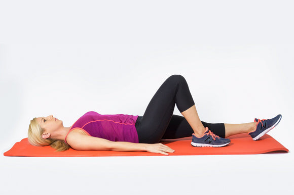 woman in starting position of single leg bridge on prosourcefit extra thick yoga and pilates mat