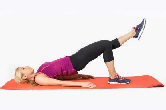 woman doing single leg raise on prosourcefit extra thick yoga and pilates mat