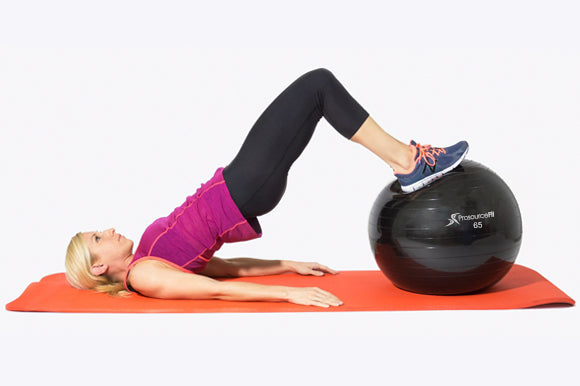 woman using prosourcefit stability ball for bridge