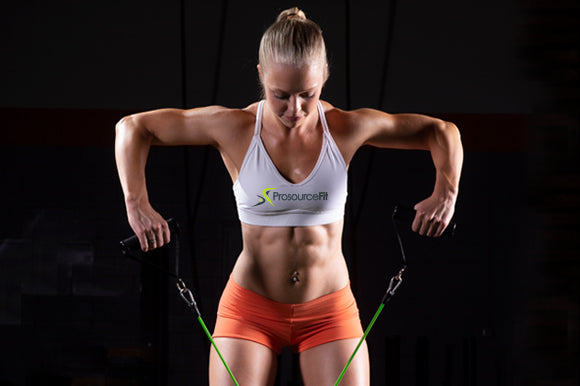 woman using prosourcefit tube resistance band with handles for bent-over row