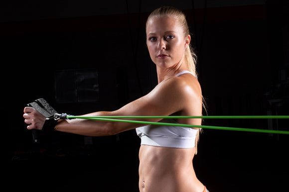 woman using prosourcefit tube resistance band with handles for core rotation exercise