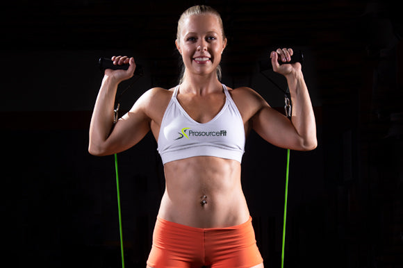 woman using prosourcefit tube resistance band with handles for shoulder press