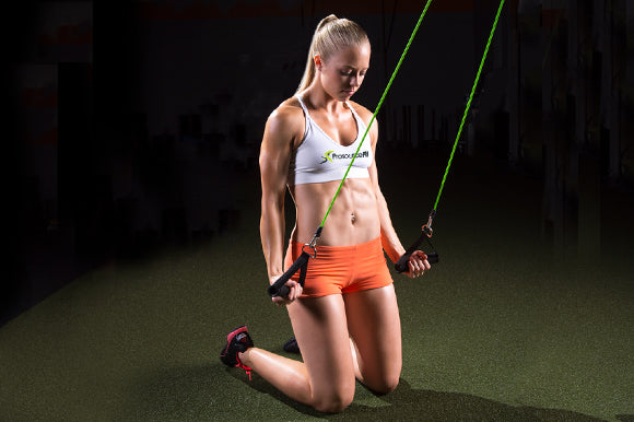 woman using prosourcefit tube resistance band tricep extensions