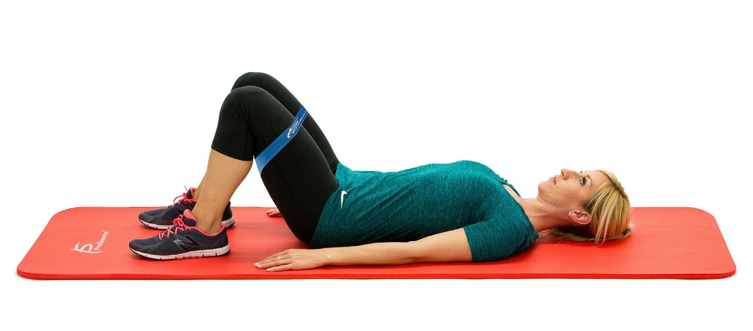 Woman lying down on ProsourceFit extra thick pilates and yoga mat doing loop resistance band bridge