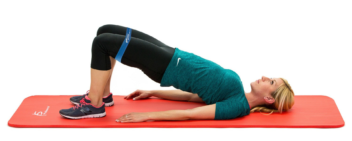Woman doing bridges on ProsourceFit extra thick pilates and yoga mat with loop resistance band b