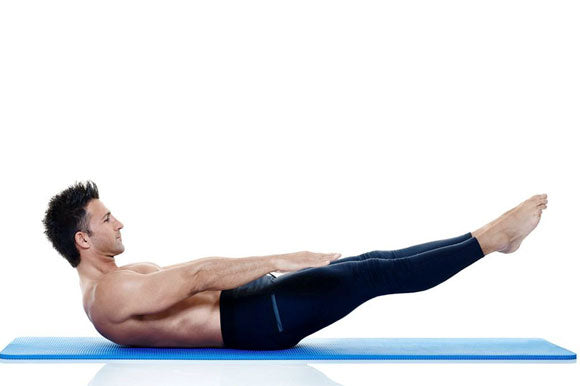 Man doing Pilates on ProSource Extra Thick Pilates Mat