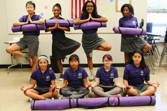 STEM school girls holding prosourcefit extra thick yoga and pilates mat