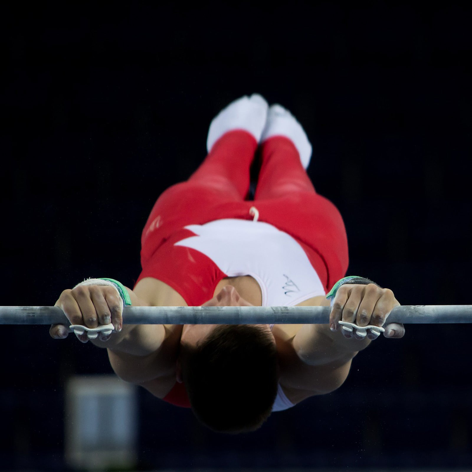 gymnast gripping bar