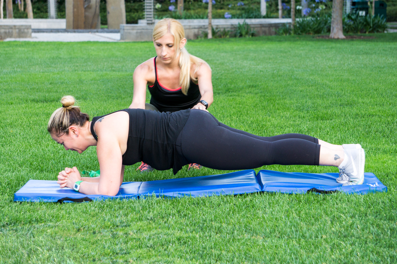 ProSource - Dianne's challenge fit for wedding - personal trainer helping client do a plank