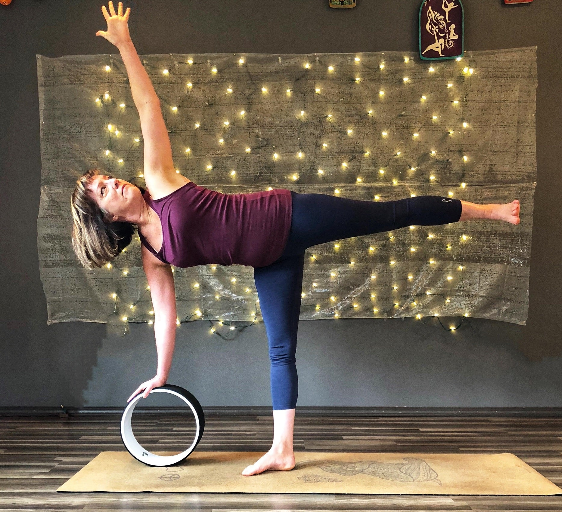 half moon pose with prosourcefit yoga wheel
