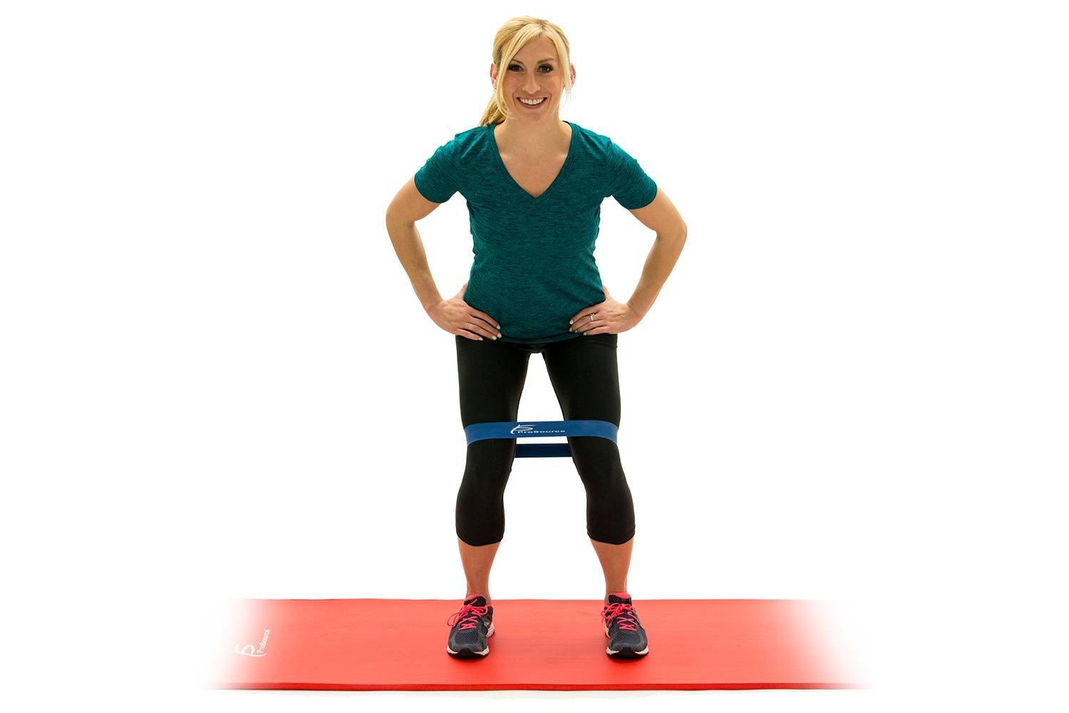 Woman doing side steps with ProsourceFit loop resistance bands on ProsourceFit extra thick yoga and pilates mat