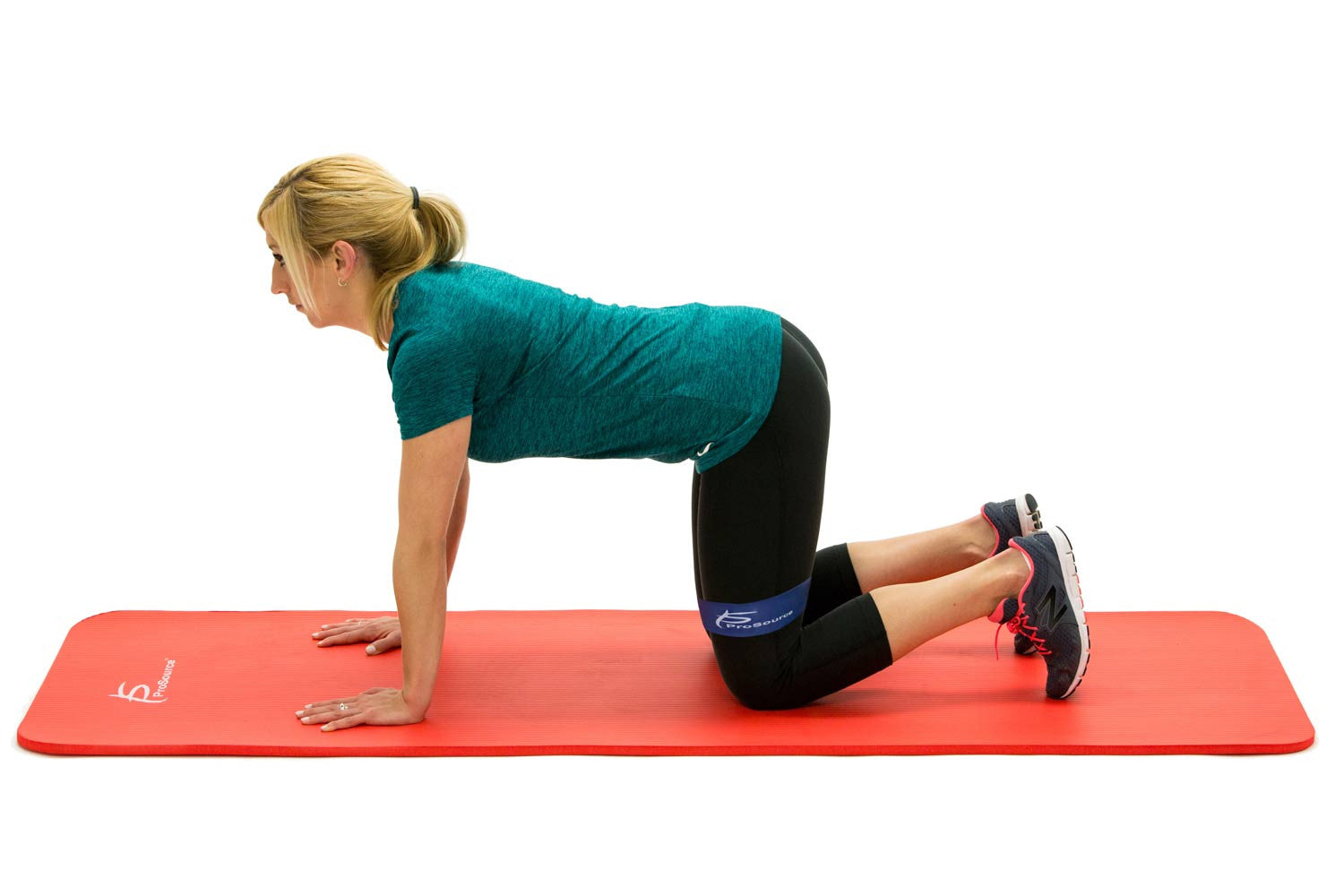 Woman using ProsourceFit loop resistance bands while knees on ProsourceFit extra thick yoga and pilates mat