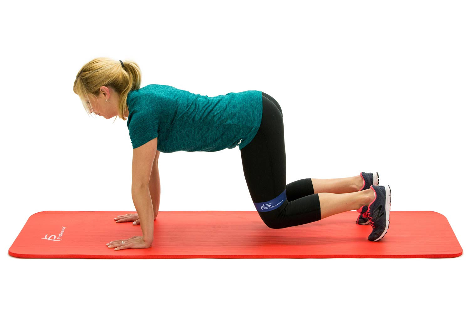 Woman using ProsourceFit loop resistance bands on ProsourceFit extra thick yoga and pilates mat