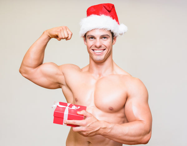 muscular man with christmas gift