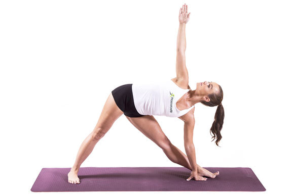 woman doing triangle pose on prosourcefit natura TPE yoga mat