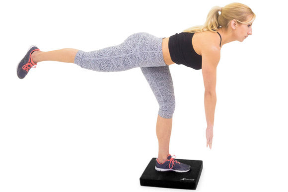 woman doing single leg balance on prosourcefit exercise balance pad