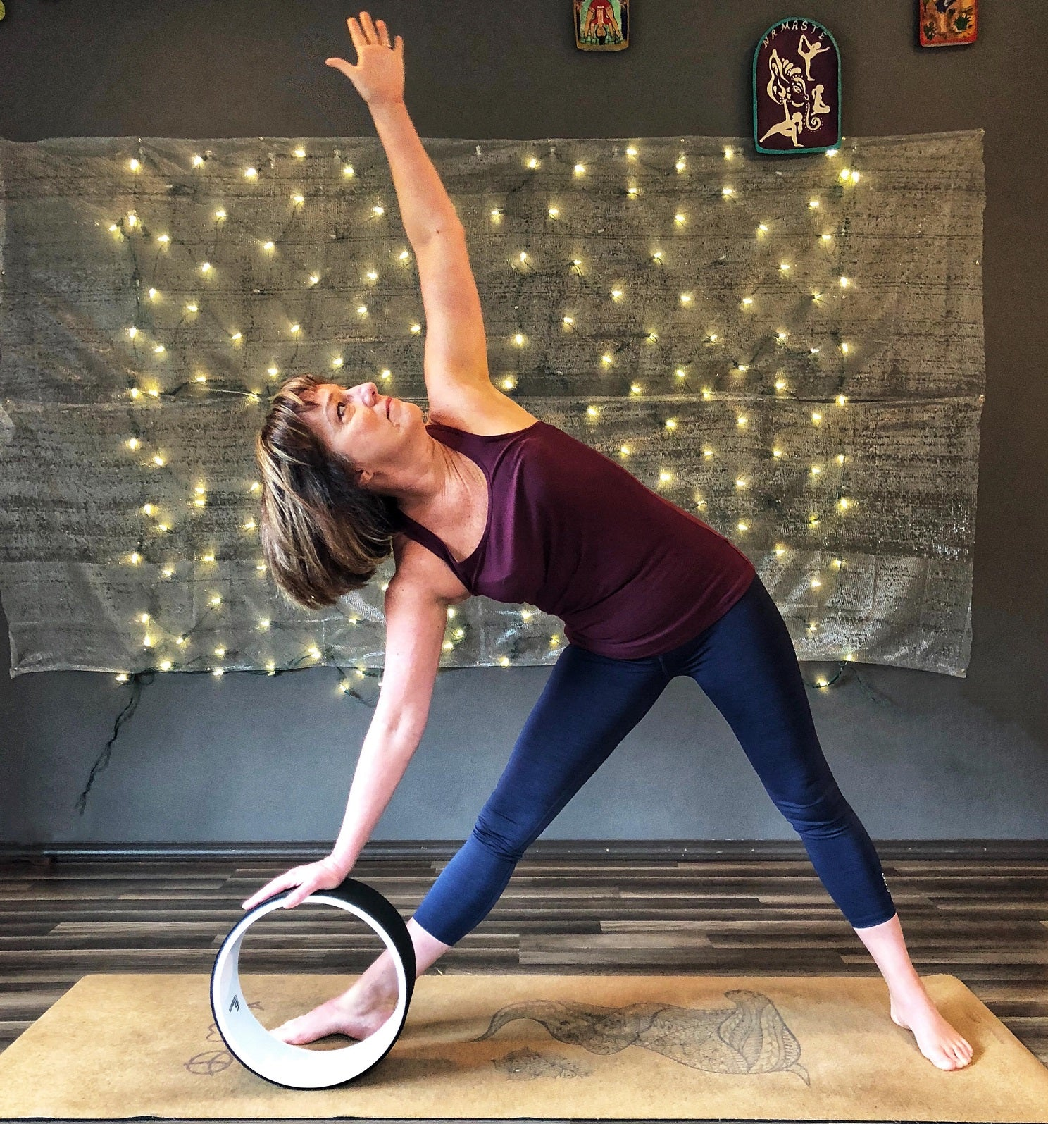 extended triangle pose with prosourcefit yoga wheel