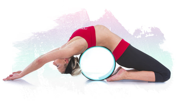 Woman stretching on ProsourceFit yoga wheel
