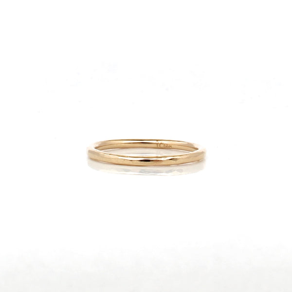thin hammered women's band in 14k yellow gold
