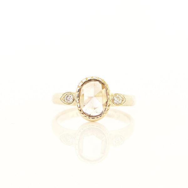 Custom champagne diamond engagement ring with white diamond accents in 14k yellow gold
