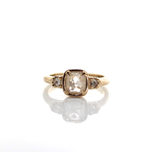 ice cushion diamond claw ring in 14 k yellow gold with rose cut diamonds on the sides