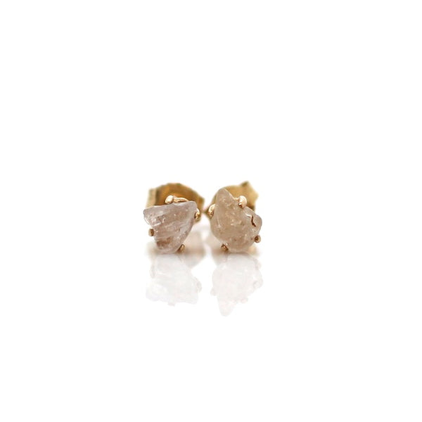 Light cream sapphire gold studs in 14k yellow gold