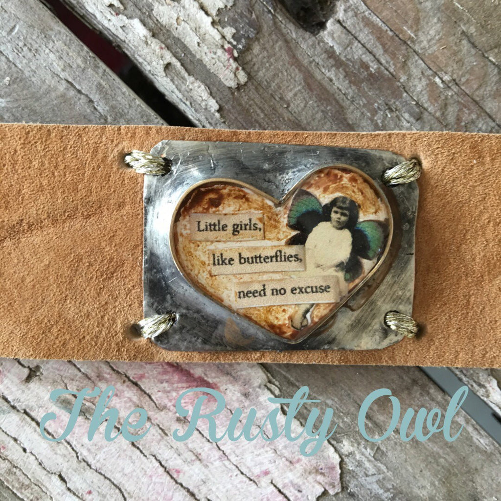 Leather Cuff Bracelet with a Heart Bezel Filled with a Fairy and the Words Little girls, like butterflies need no excuse CL-003