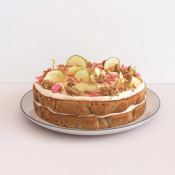 *Cake of the Month* DOUBLE LAYER APPLE & RHUBARB CRUMBLE CAKE with rhubarb cream cheese icing, freeze dried rhubarb, apple chips & cinnamon almond crumble topping