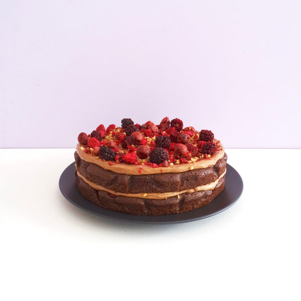 *Limited Edition* DOUBLE LAYER BLACK FOREST CAKE with chocolate cream cheese icing, freeze dried cherries, blackberries raspberries, and crunchy hazelnut praline