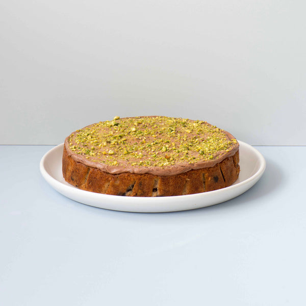 DARK CHOCOLATE, PEAR AND PISTACHIO CAKE with chocolate cream cheese icing and topped with more pistachios