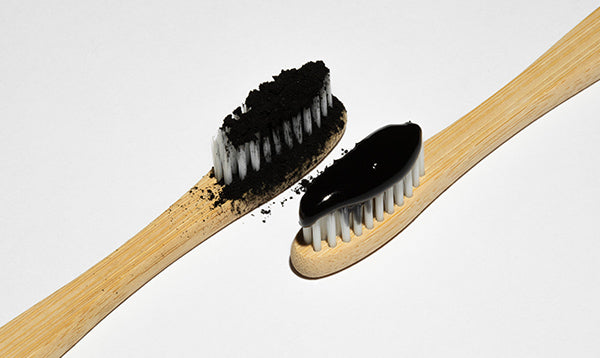 Whitening Toothpastes with activated charcoal next to the more abrasive option of brishing with charcoal poweder.