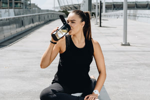 mous fitness bottle with lemon lady doing yoga drinking from bottle